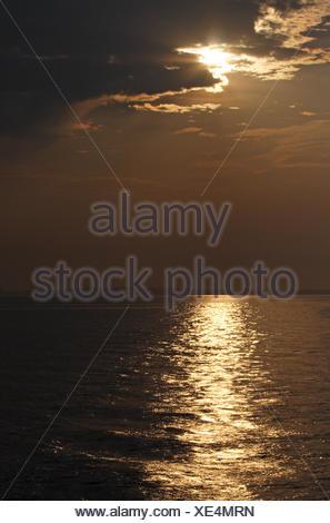 sunset sunrise water baltic sea salt water sea ocean evening tendency mirroring - Stock Photo