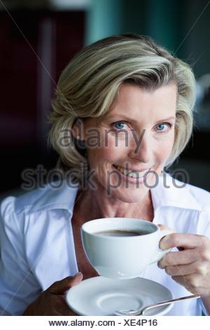 Senior Woman Drinking Tea - Stock Photo