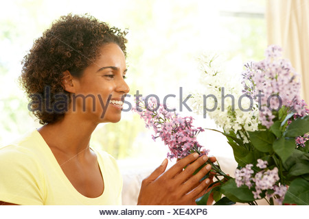 Woman Flower Arranging At Home - Stock Photo