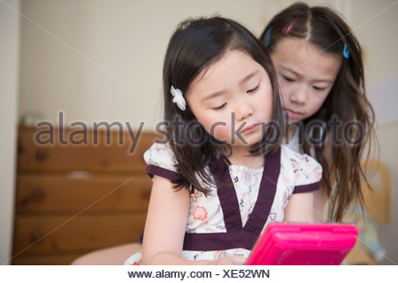 Two young female friends unhappy with one computer game - Stock Photo
