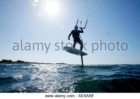 Kite Surfer Mayeul Riffet in action on a foiling kiteboard, Lorient, Brittany, France. - Stock Photo