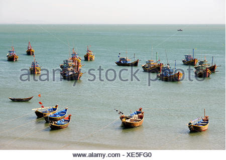 Fishing boats in the fishing port of Mui Ne on the South China Sea, South Vietnam, Southeast Asia - Stock Photo