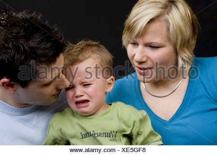 parents with their crying son - Stock Photo
