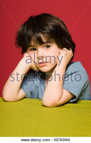 Little boy daydreaming, portrait - Stock Photo