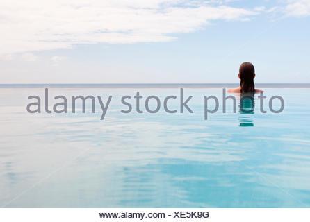 USA, Virgin Islands, St. John, Woman in swimming pool - Stock Photo