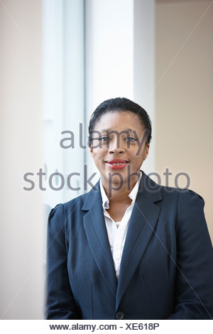 Portrait of businesswoman looking at camera - Stock Photo