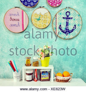 Home sweet home arrangement of food, flowers and decorations - Stock Photo