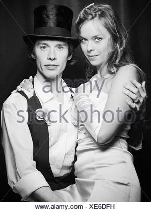 Newlywed couple hugging - Stock Photo