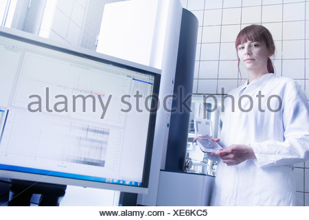 Scientist using equipment in lab - Stock Photo