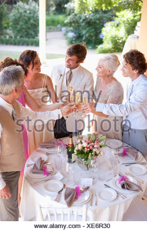 Guests toasting champagne wedding reception - Stock Photo