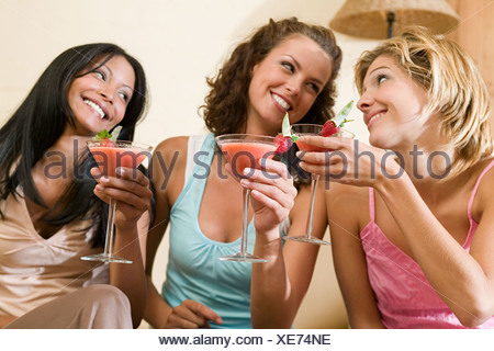 Friends drinking cocktails - Stock Photo