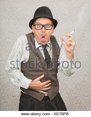 Smoking Man Feeling Sick - Stock Photo