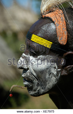 Karo chief with a white painted face, a clay headdress and colorful headband, profile portrait, Kolcho, South Omo Valley, Ethio - Stock Photo