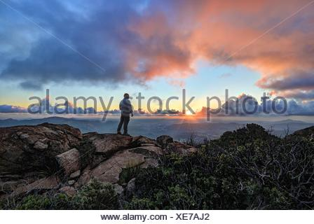 Mature man standing on a mountain at sunset, Cleveland National Forest, USA - Stock Photo
