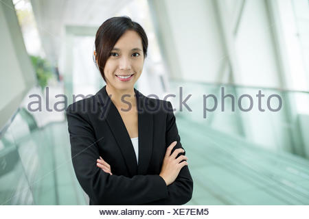 Businesswoman standing at office - Stock Photo