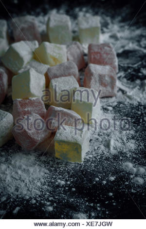 Classic Turkish delights in two colors dusted with starch. - Stock Photo