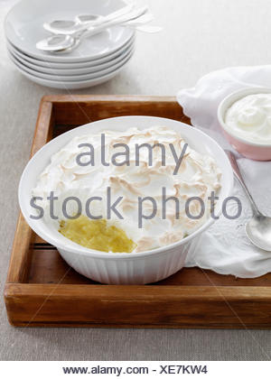 Dish of baked meringue and fruit - Stock Photo