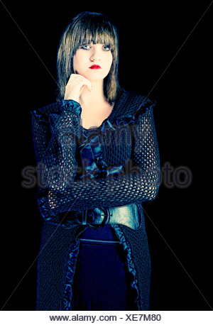 Mysterious young girl with dark makeup dressed in black - Stock Photo