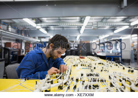 helicopter technician repairing wiring harness stock photo 92725351 rh alamy com Ford Wiring Harness Kits Engine Wiring Harness