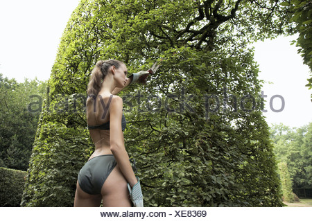 junge frau im bikini mit rasenmaeher im garten young woman wearing a stock photo 26578017 alamy. Black Bedroom Furniture Sets. Home Design Ideas