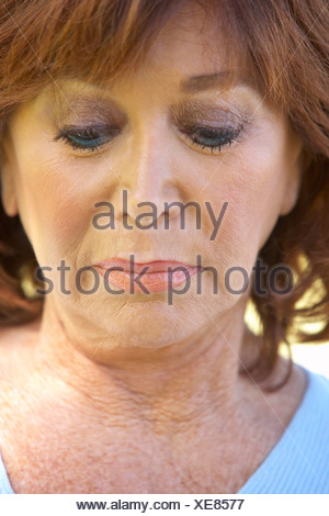 Portrait Of Middle Aged Woman Looking Unhappy - Stock Photo