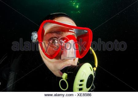 Diver and Freshwater Jellyfish, Craspedacusta sowerbii, Lake Lugano, Switzerland - Stock Photo
