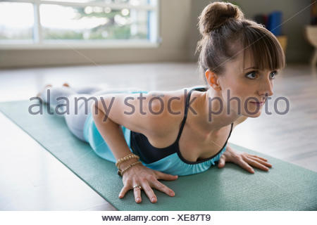Woman practicing yoga in baby cobra pose - Stock Photo