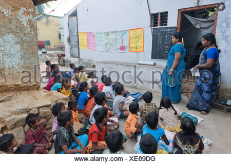 Teachers and pupils, night school, Sevandhipalayam near Karur, Tamil Nadu, South India, Asia - Stock Photo