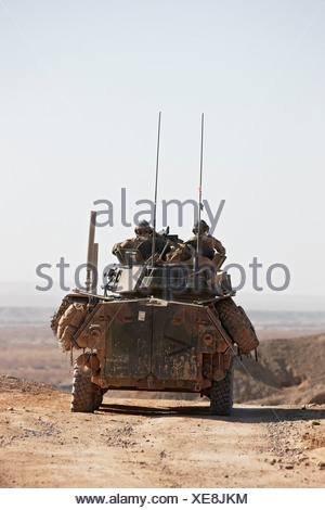 U.S. Marines 4th Light Armored Reconnaissance ride in LAV-25 or Light Armored Vehicle in southern portion Afghanistan's Helmand - Stock Photo