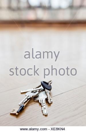 Bunch of keys lying on floor - Stock Photo