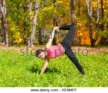 Yoga Ardha Chandra chapasana pose - Stock Photo