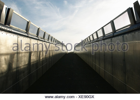 Steel footbridge over railway Kent UK - Stock Photo