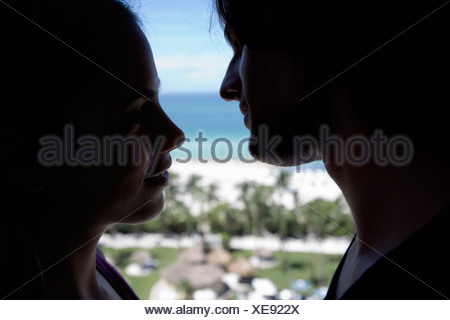 Young couple about to kiss - Stock Photo