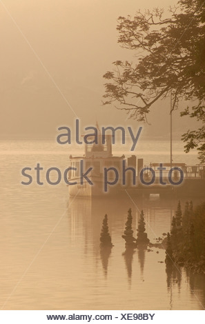 Morning fog and a ship in Grundlsee in northern Styria, Austria, Europe - Stock Photo