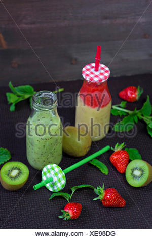 Two glass bottles of different smoothies - Stock Photo