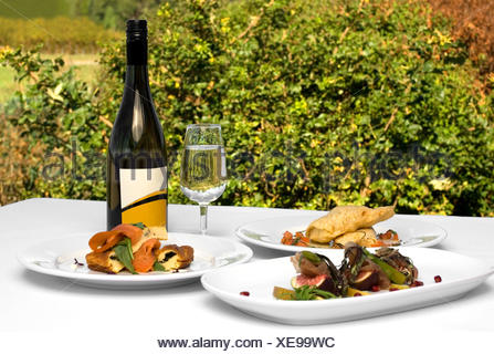 restaurant glass chalice tumbler food aliment green alcohol angle fish fruit - Stock Photo