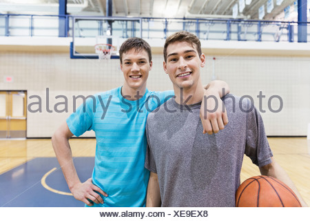 Portrait of male basketball players in gym - Stock Photo