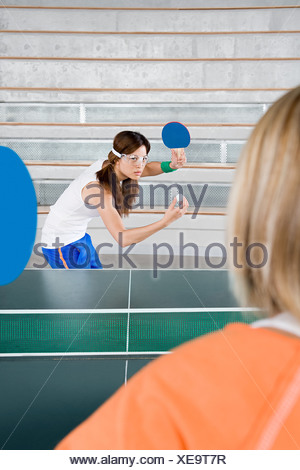 Two women playing table tennis - Stock Photo