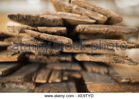 A heap of recycled reclaimed timber planks of wood Environmentally responsible reclamation in a timber yard - Stock Photo