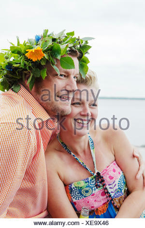 Sweden, Uppland, Roslagen, Couple embracing outdoors - Stock Photo