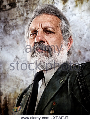 Portrait of senior man wearing military uniform - Stock Photo