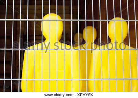 Yellow Football dummies behind wire fence Munich Germany - Stock Photo