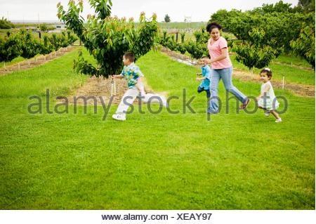 Children running in grass - Stock Photo