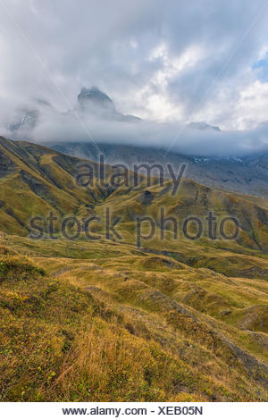 The Aiguille d'Arves hidden by fog and clouds, Ecrins, Savoie,  France - Stock Photo