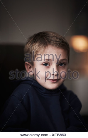 Close up of smiling boys face - Stock Photo