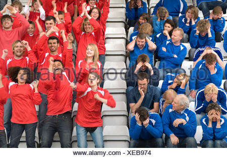 Rival fans at football match - Stock Photo