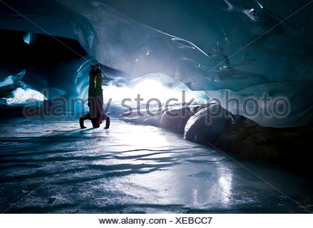 Ice Cave Yoga - Stock Photo