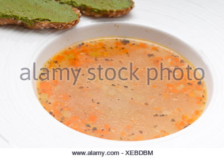 Italian minestrone soup with pesto crostini on side - Stock Photo