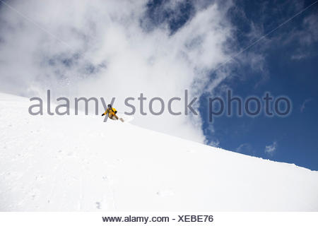Man downhill skiing in deep snow, Davos, Grisons, Switzerland - Stock Photo