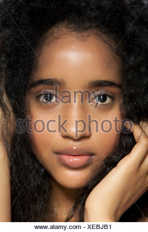 Young woman with hands in hair, close up, portrait - Stock Photo